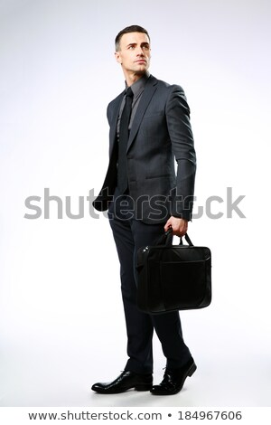 Full-length portrait of a thoughtful businessman with bag isolated on a white background Stock photo © deandrobot