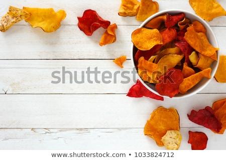 Croccante radice vegetali chip colorato isolato Foto d'archivio © Klinker