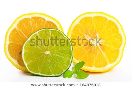 Fraîches juteuse citron feuille verte isolé blanche Photo stock © tetkoren