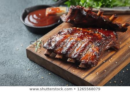Delicioso grelhado carne de porco costelas servido rico Foto stock © juniart