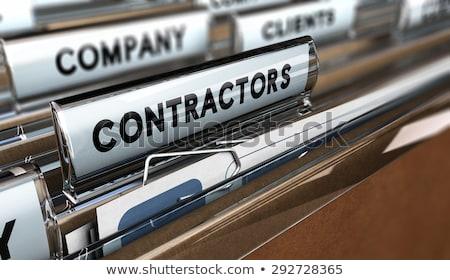 Contractors Concept with Word on Folder. Stock photo © tashatuvango