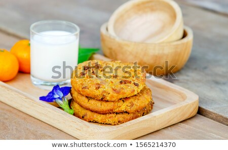 Stock photo: Homemade cheese, a glass of milk, brown bread on a wooden tray.