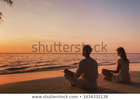 Silhouette practicing yoga in space background Stock photo © ankarb