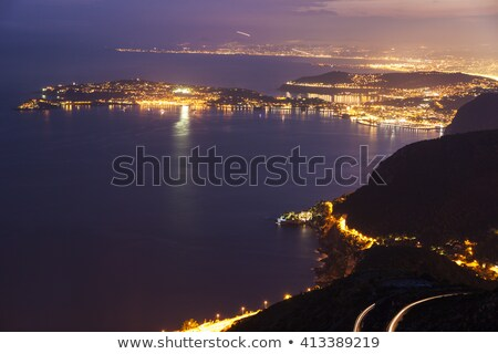Distant view of Saint Jean Cap Ferrat and Nice at sunset Stock photo © benkrut