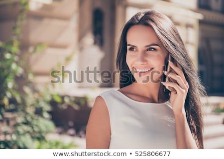 portrait of a young business woman talking on mobile phone stock photo © deandrobot