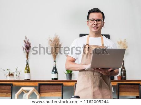 Sorridere utilizzando il computer portatile counter ristorante ritratto computer Foto d'archivio © wavebreak_media