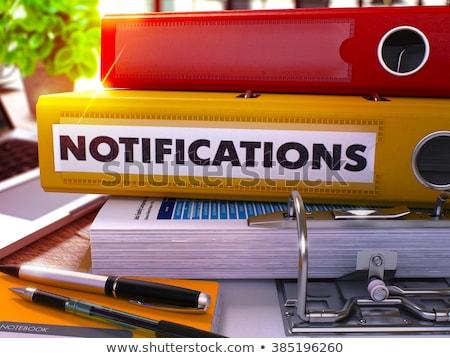yellow office folder with inscription notifications stock photo © tashatuvango