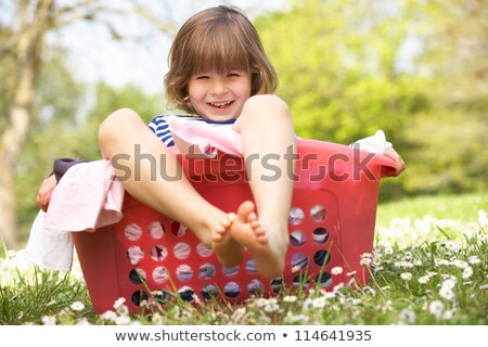 Bambino cestino di lavanderia ridere ragazza capelli giovani Foto d'archivio © IS2