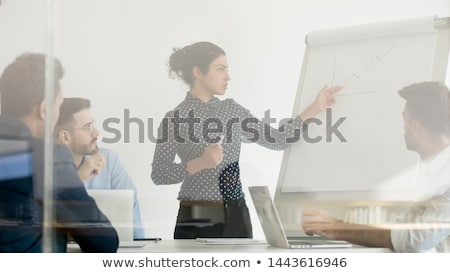 Hindu businessman showing financial chart. Stock photo © RAStudio
