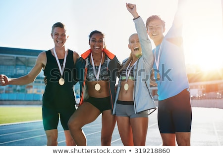 Läufer Medaillen Fitness Erfolg lächelnd Stock foto © IS2