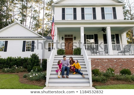 Family standing on stairs Stock photo © IS2