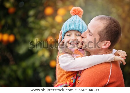 young girl picking oranges with parents stock photo © is2