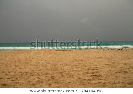 Cloudy dramatic sky in caribbean turquoise sea Stock photo © lunamarina