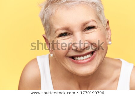 Confident beauty. Cheerful mature woman studio stock photo © Lopolo