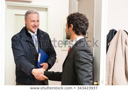 üzletember vendég iroda üzlet boldog ajtó Stock fotó © Minervastock