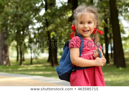 Beautiful little girl with backpack ready back to school Stock photo © Lopolo
