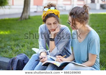 Girls studying at the park Stock photo © Minervastock