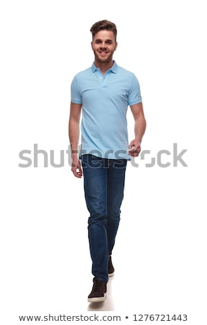 attractive casual man wearing blue polo t-shirt steps forward Stock photo © feedough