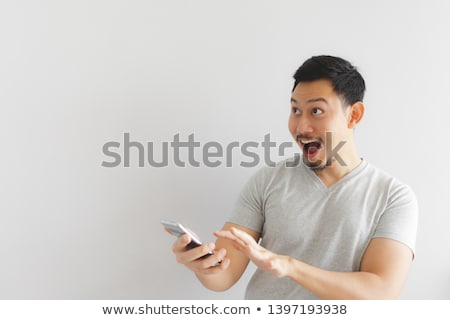 man gets into the smartphone stock photo © studiostoks