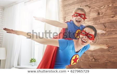 Girl and mom in Superhero costume Stock photo © choreograph