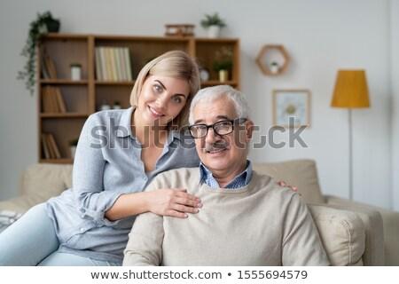 Afetuoso casal de idosos relaxante sofá país casa Foto stock © pressmaster