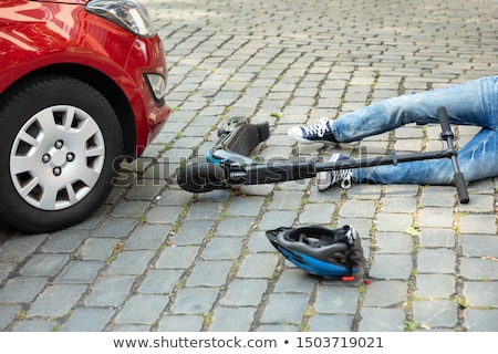 Foto d'archivio: Man With An Electric Scooter After Accident
