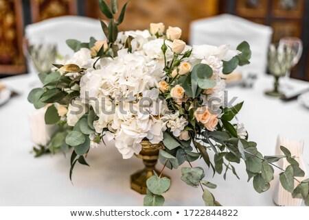 Creative florist arranging wedding bouquet Stock photo © pressmaster