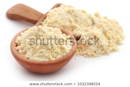Gram flour in bowl and wooden scoop Stock photo © bdspn