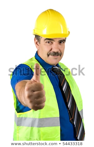 architect or businessman in helmet shows thumbs up stock photo © dolgachov