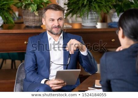 Başarılı zarif işadamı touchpad gözlük konuşma Stok fotoğraf © pressmaster