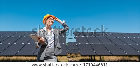 Business woman or investor inspecting her solar farm Stock photo © Kzenon