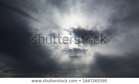 Big cumulus clouds lighted sunny beams. Stock photo © artjazz