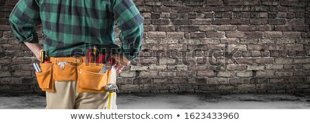 Contractor With Tool Belt Facing Aged Brick Wall Banner Stock photo © feverpitch