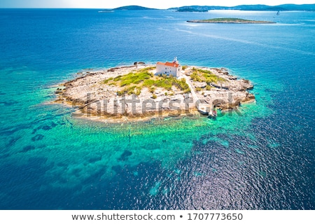 Aerial view of lonely island with lighthouse, Korcula riviera is Stock photo © xbrchx