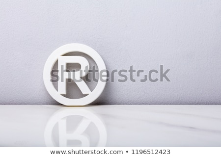 Registered Trademark Sign Leaning On Wall Stock photo © AndreyPopov