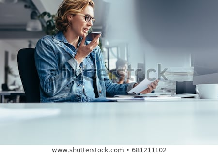 businesswoman using smart speaker at office Stock photo © dolgachov