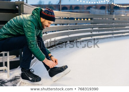 People, sport, winter, leisure concept. Smiling delightful male  Stock photo © vkstudio