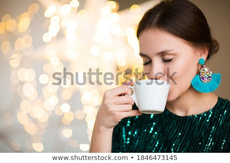 Crop woman enjoying smell of hot beverage Stock photo © dashapetrenko