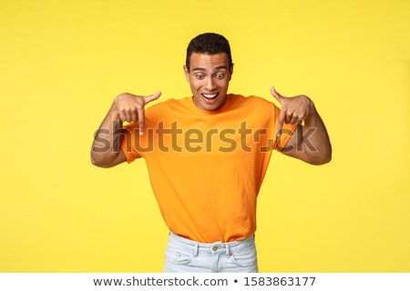 Izgatott jóképű spanyol férfias fickó visel Stock fotó © benzoix
