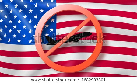 Warning sign with crossed out plane on the background of American flag. Stock photo © artjazz