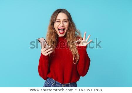 Kép örömteli nő tart mobiltelefon gesztikulál Stock fotó © deandrobot