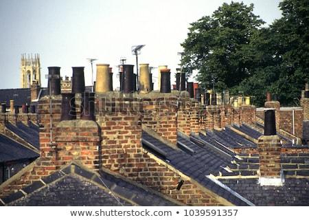 Many Chimneys on rooftop Stock photo © deyangeorgiev