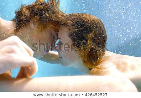 Happy teenage couple at the pool Stock photo © rosspetukhov