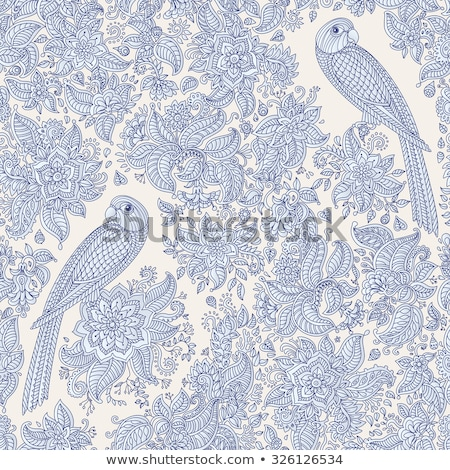 A cute, little bird and a flower on beige background Stock photo © Julietphotography