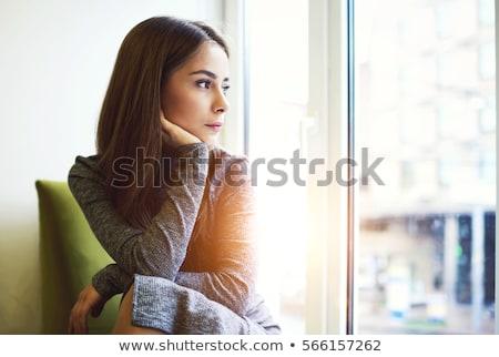 portret · jonge · vrouw · naar · uit · venster · vergadering - stockfoto © lightpoet