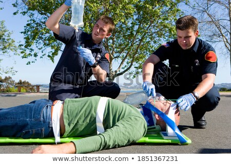 patient on a drip with his medical team stock photo © photography33