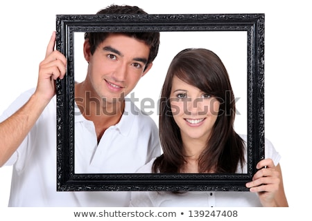 Couple holding empty art frame Stock photo © photography33