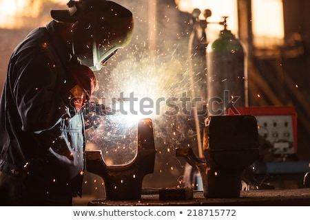 Man at work as welder in heavy industry stock photo © diego_cervo