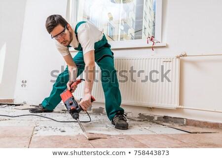 Man replacing flooring Stock photo © photography33