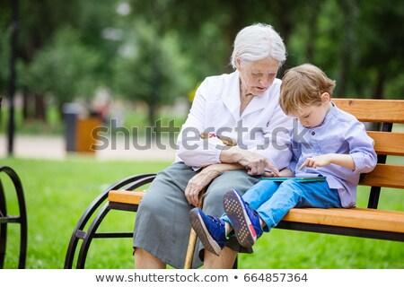 çift · oturma · bank · bahar · çim - stok fotoğraf © photography33
